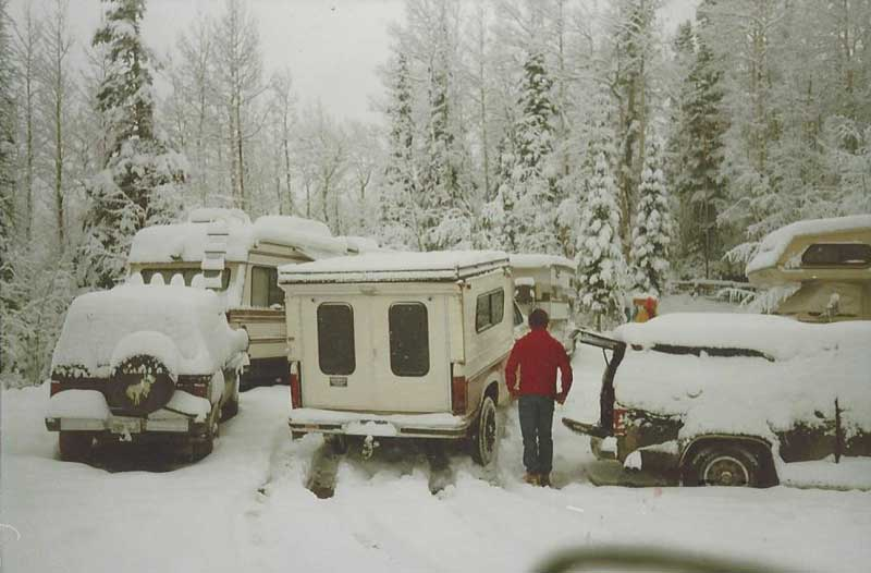 Old photo of a Callen Camper covered in snow