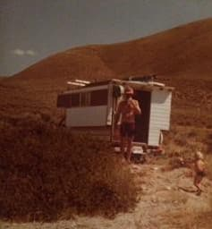 Old picture of family playing around a Callan Camper