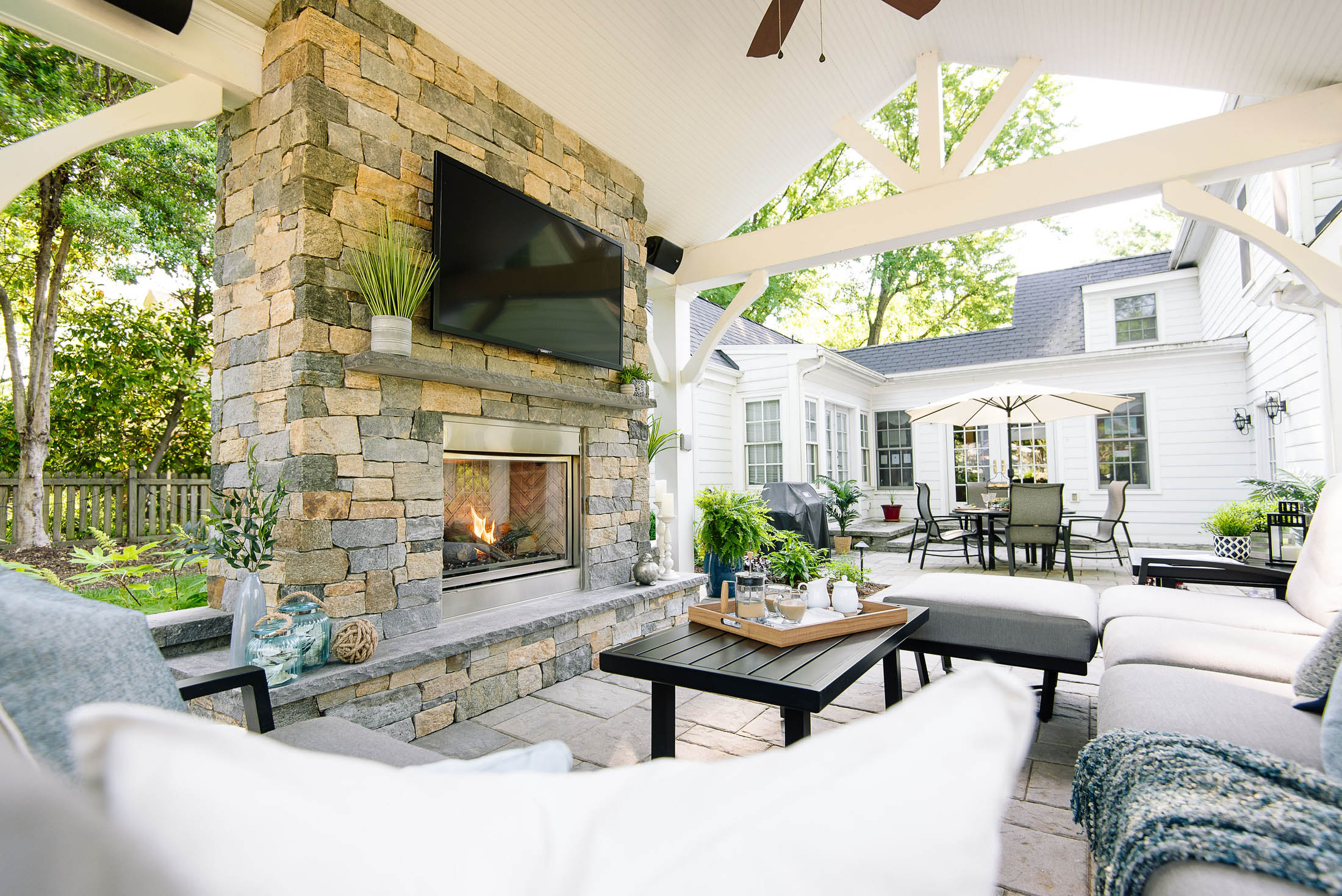 Outdoor living space with gas fireplace, pavilion, and outdoor television