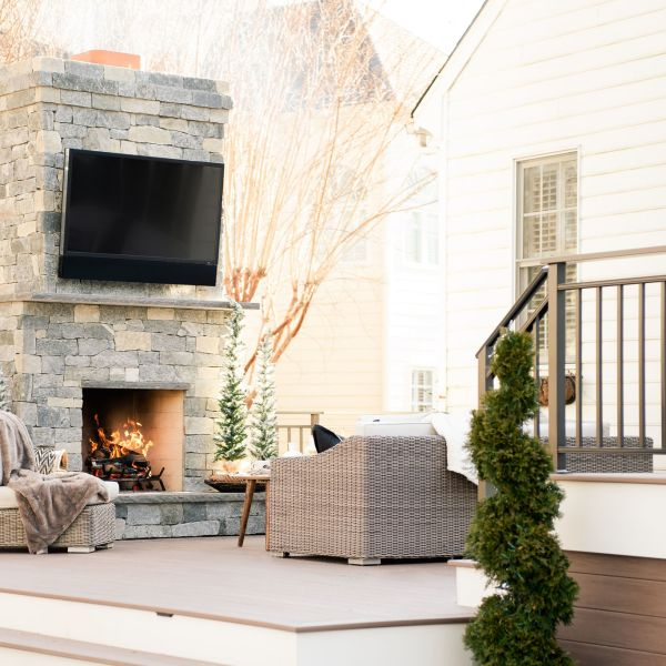 custom outdoor fireplace and tv with patio furniture