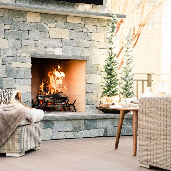 cozy outside custom stone fireplace