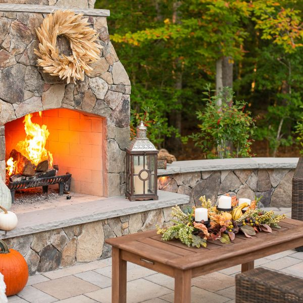 Large outdoor stone fireplace and hearth