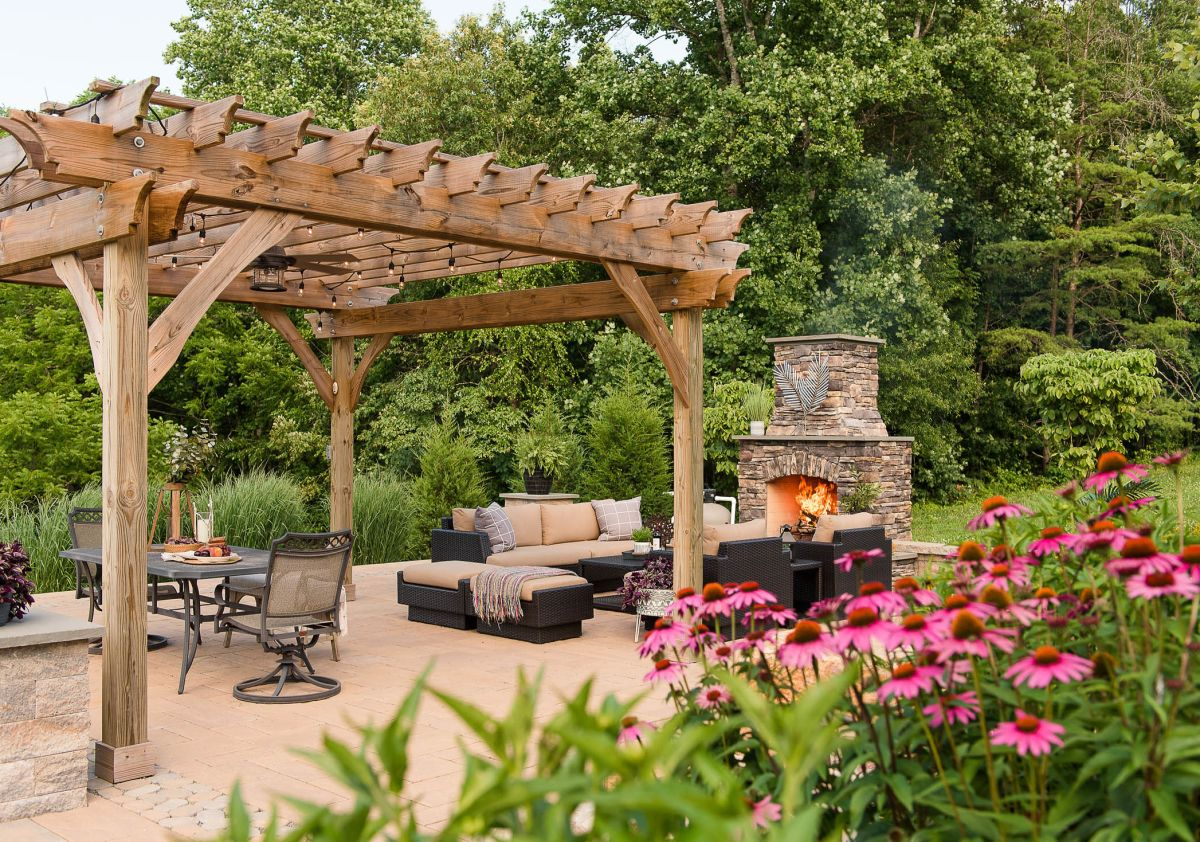 Open backyard patio with pergola and fireplace entertainment area