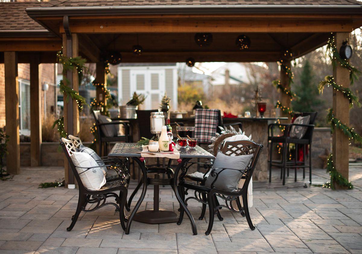 backyard hardscaped patio with pavilion and stone bar