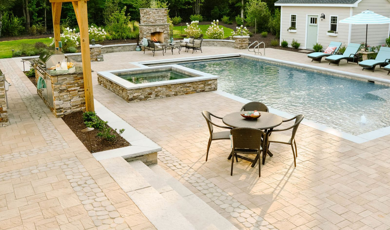 Backyard fiberglass pool and hot tub and entertainment area