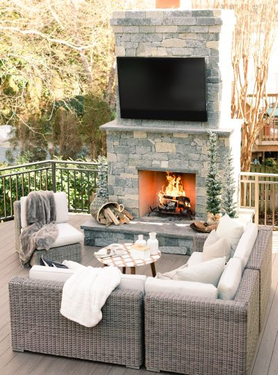 Newly Installed backyard deck with a fireplace and entertainment center