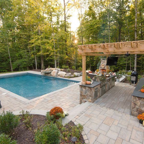 Beautiful outdoor space designed with pergola, kitchen and pool