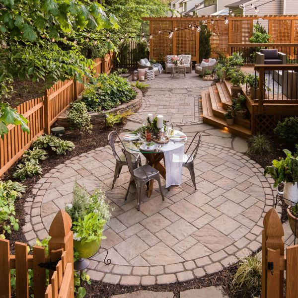 Paver patio with deck and landscaping