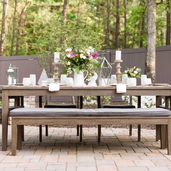 Outdoor dining table on a Techo-bloc paver patio.