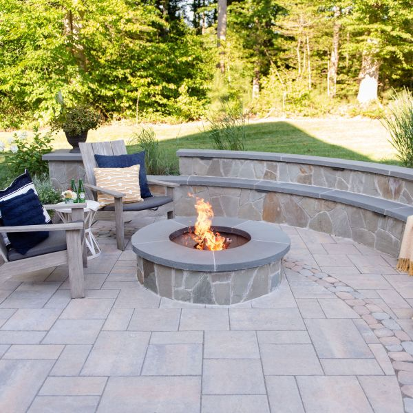 Wood burning fire pit with bench-style sitting walls
