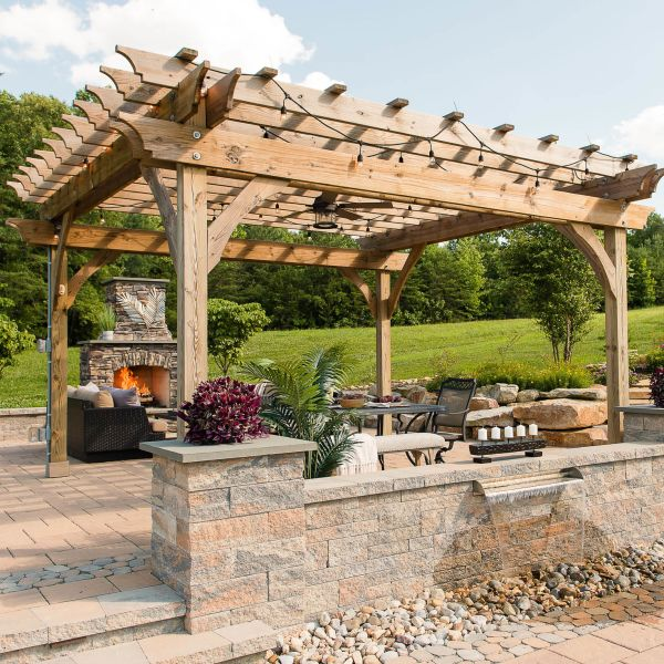 Paver patio with pergola, wall fountain, sitting walls, pillars, and outdoor fireplace