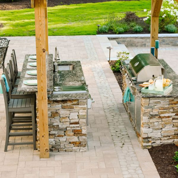 Techo block paver patio with outdoor kitchen installed