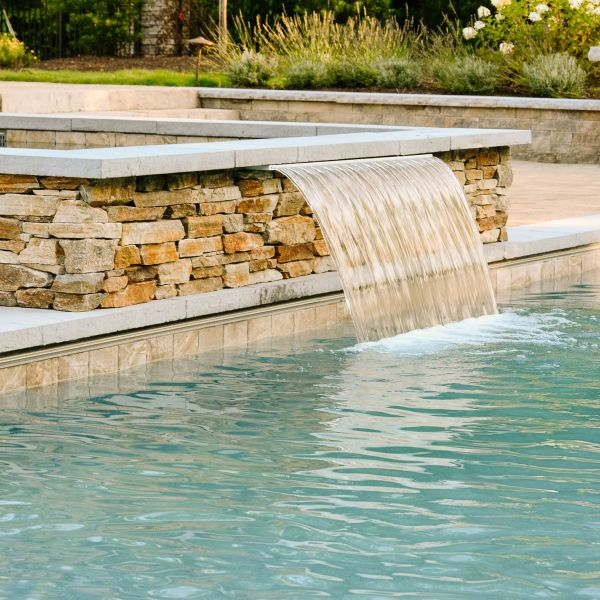 Hot Tub water fountain leads into the pool