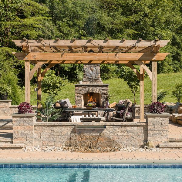 Tuscany inspired sitting area nearby the fire place and backyard pool