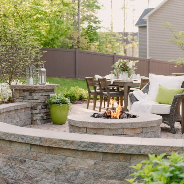 Gas fire pit with sitting wall and pillars.