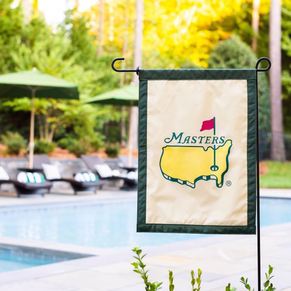 Masters lawn flag displayed in front of the backyard pool