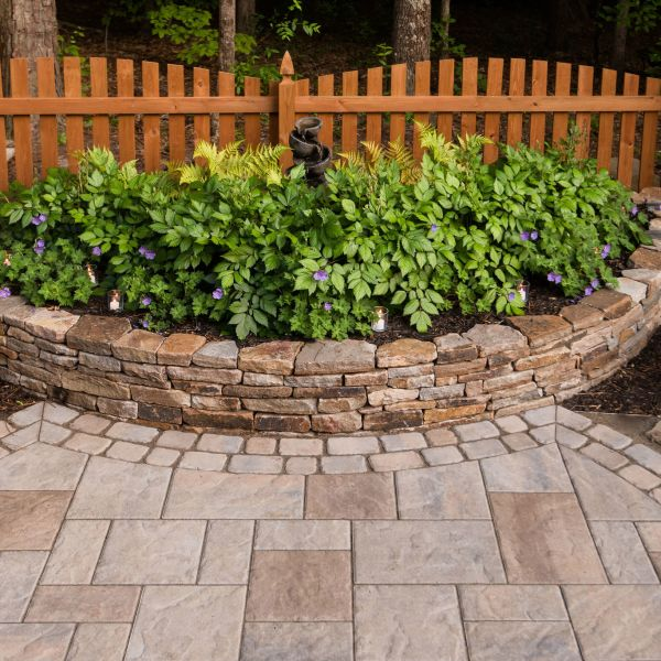 Natural stone stacked stone wall with landscaping