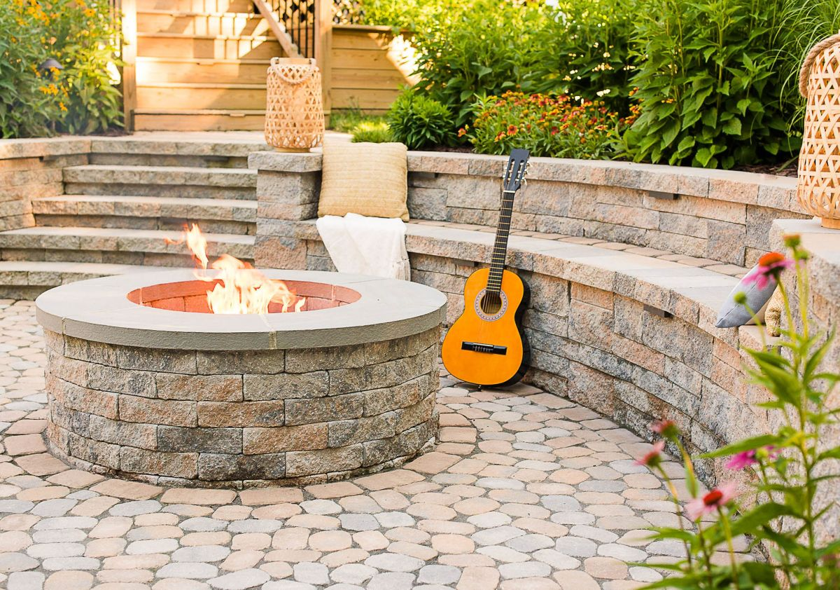Christmas time outdoor living space in front of a stone fireplace