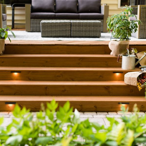 Wide deck steps with container gardening