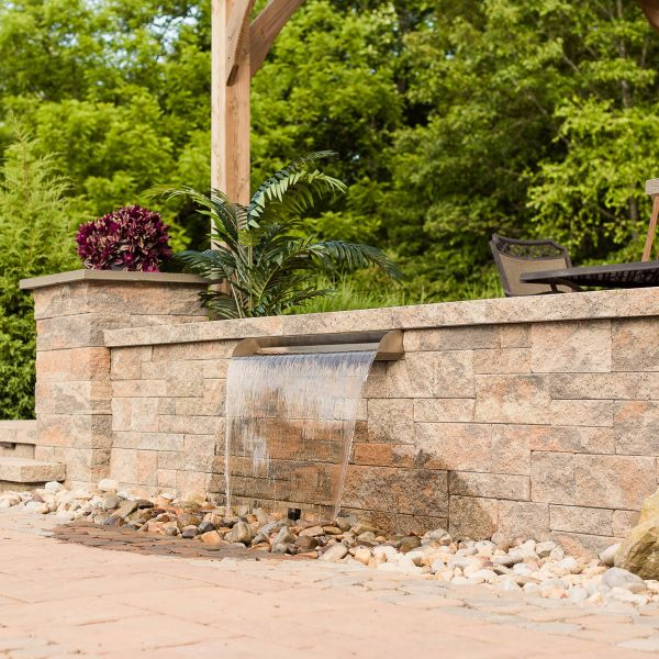 Paver patio with wall fountain