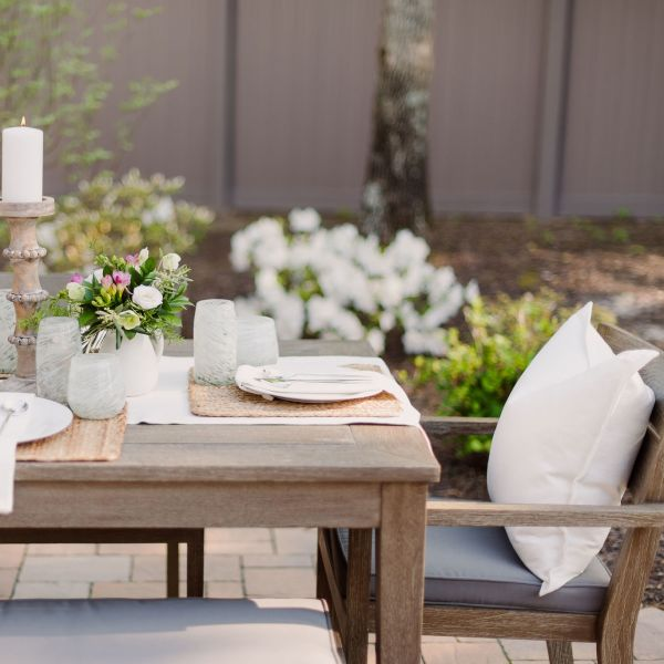 Outdoor Dining Table setting on a paver patio.