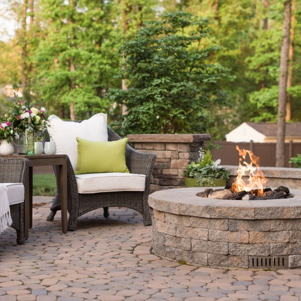 Gas fire pit on a paver patio.