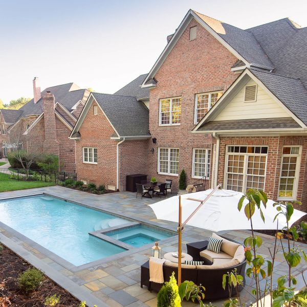 Beautiful, large brick home with backyard pool and sitting area