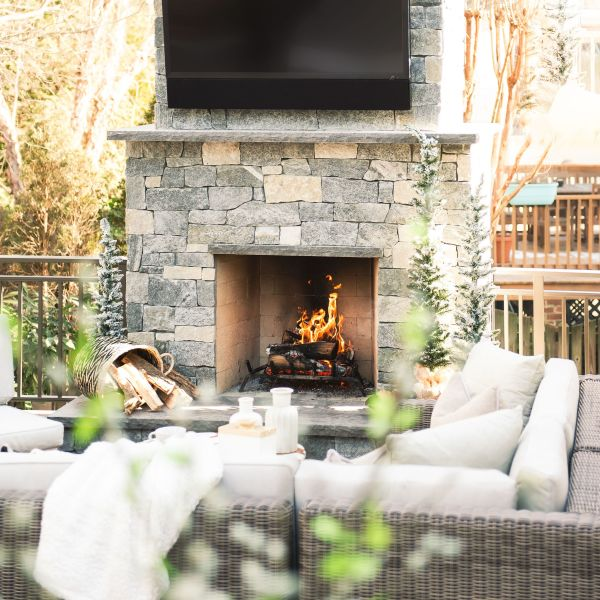 outdoor entertainment center and fireplace