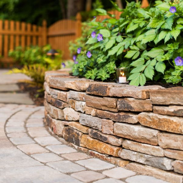 Stacked stone wall with landscaping
