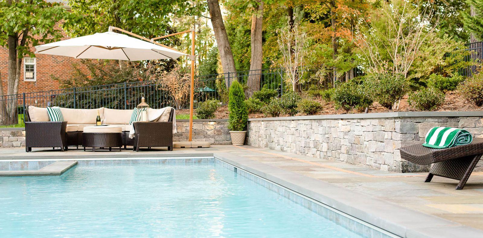 Pool with hot tub and bluestone patio