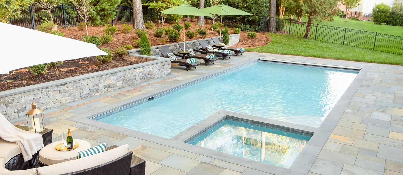 Paver patio with fire pit and retaining wall