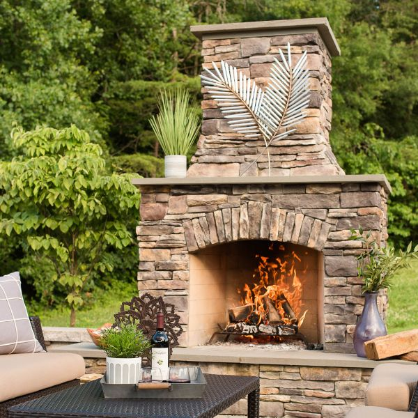 outdoor fireplace on a paver patio