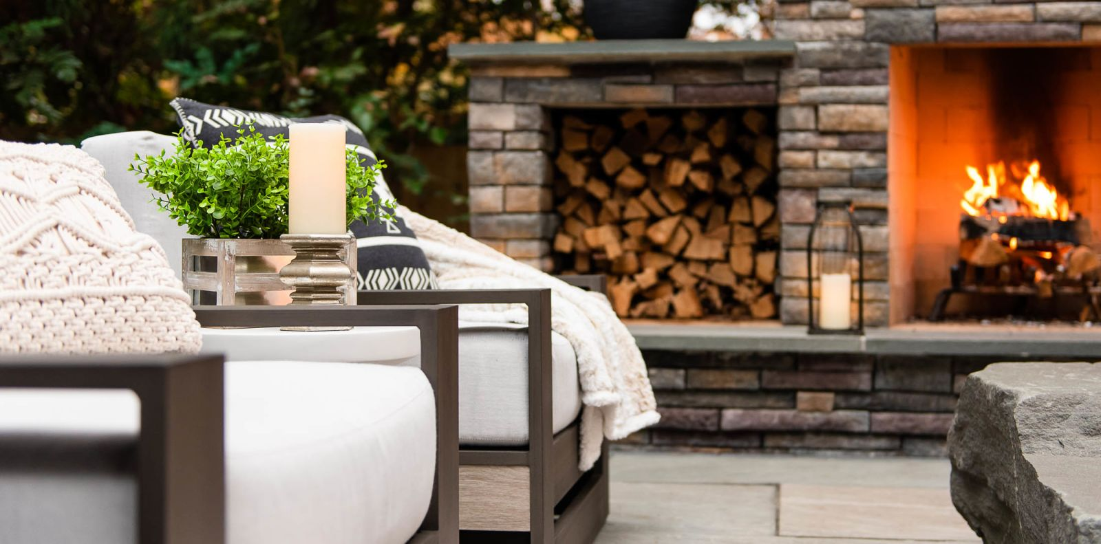 hardscaped backyard with fire place and stone