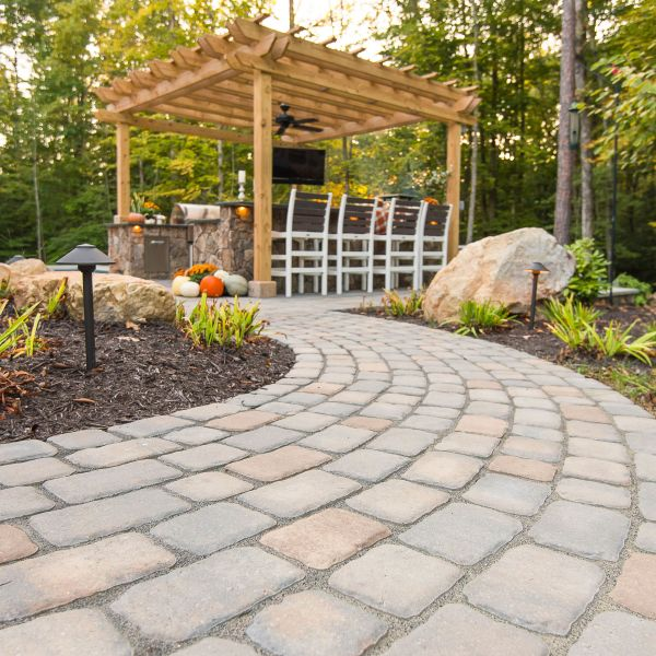 Natural stone paver outdoor path leading to pergola
