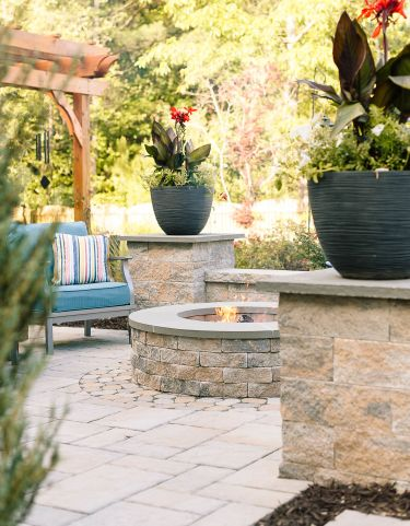Beautifully designed outdoor space with pergola and fire pit