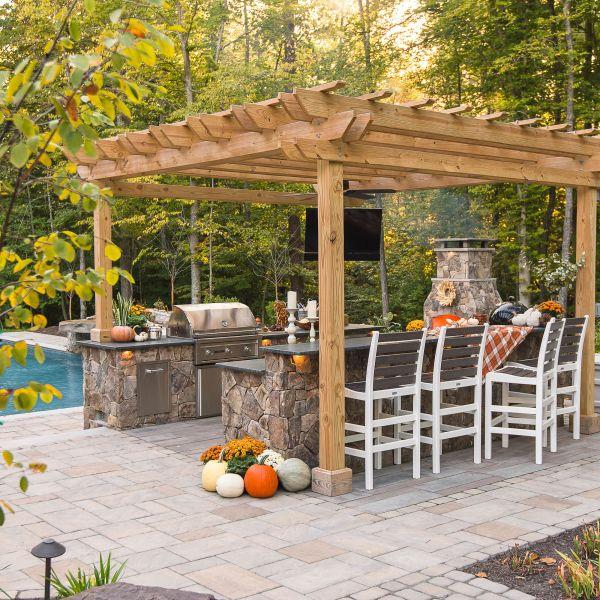 Pergola installed over backyard kitchen near the pool