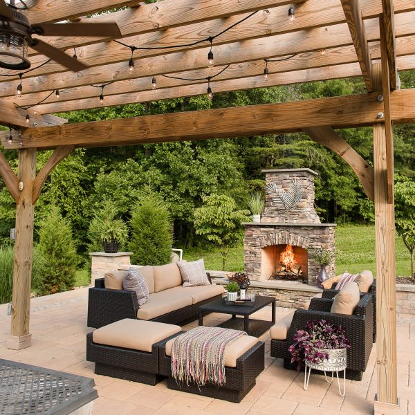 Paver patio with outdoor fireplace and pergola
