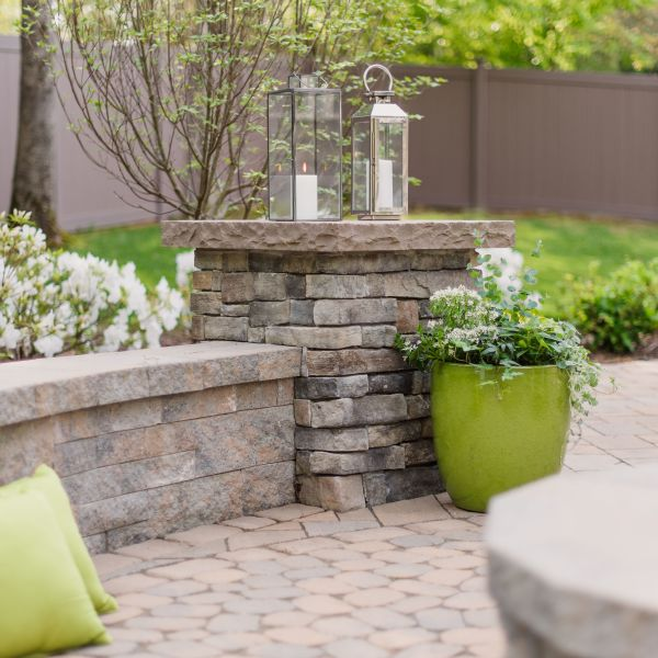Eldorado stone pillar on a Techo-Bloc paver patio.