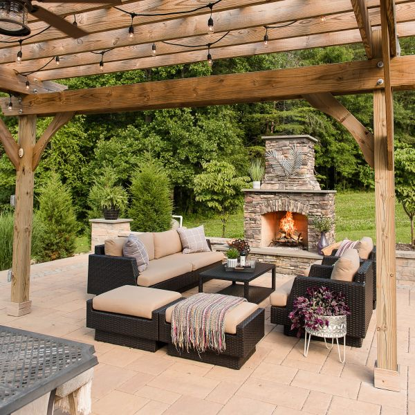 Relax under this newly installed pergola near the double stacked fireplace