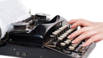 hands-typing-on-classic-typewriter-o