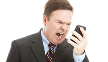 angry-man-yelling-in-to-mobile-phone-o