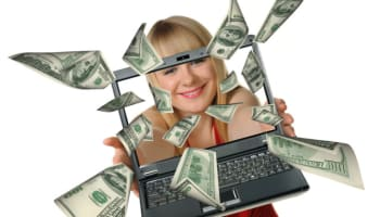 happy-woman-with-money-notes-falling-on-to-laptop-computer-screen-o-640×513