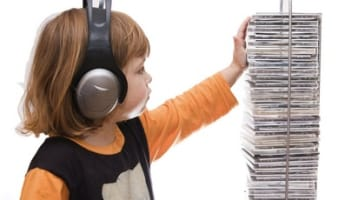 little-girl-child-grabbing-music-cd-and-listening-to-digital-music-with-hea-o