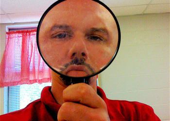 face-in-a-magnifying-glass-o-640×535
