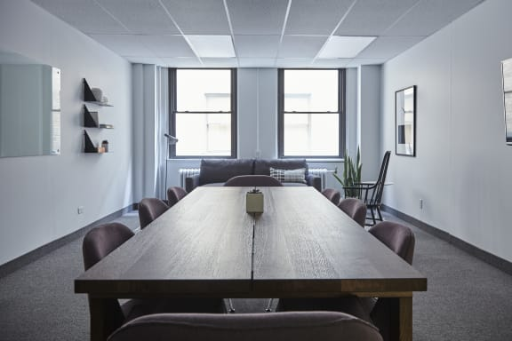 Workspace fully furnished and equipped located at 1396 Rue Ste-Catherine O., #210, Montreal.