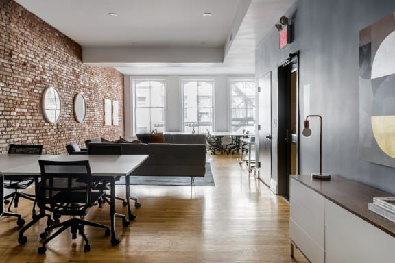 Workspace fully furnished and equipped located at 494 Broadway, New York City.