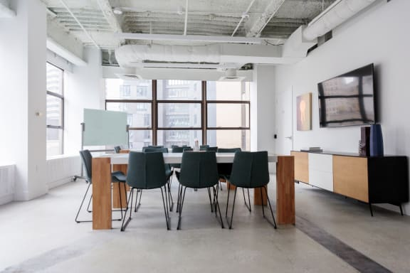 Workspace fully furnished and equipped located at 55 Broad Street, New York City.