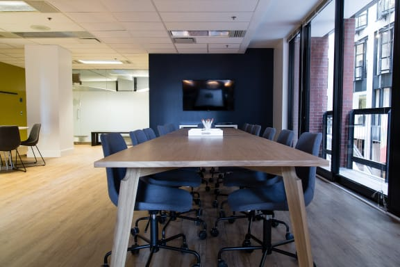 Workspace fully furnished and equipped located at 747 Rue du Square-Victoria, #2020, Montreal.