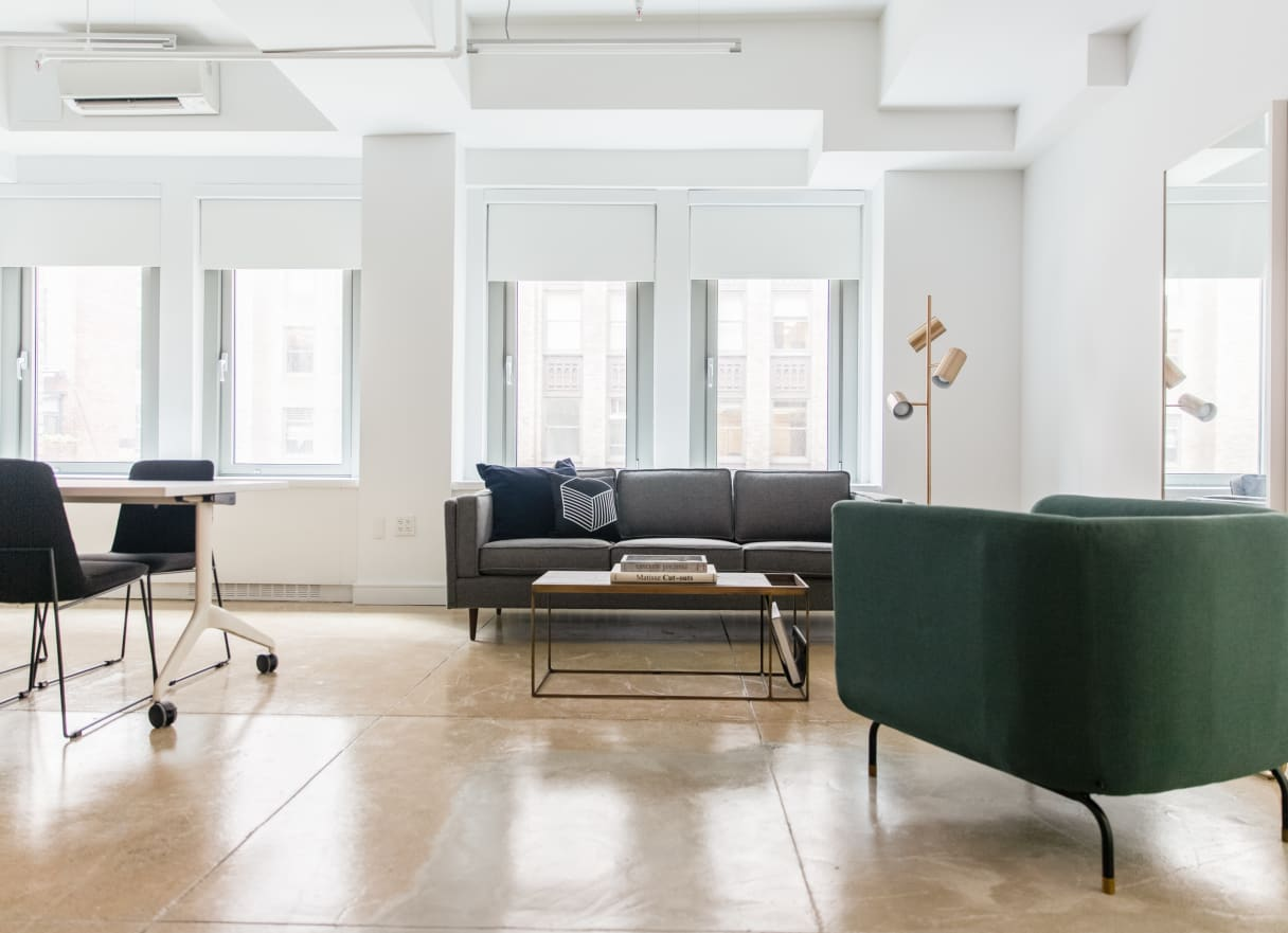 Bright Breather office space furnished with work table and chairs and lounge seating.
