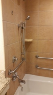 <h5>Gaylord Texan Resort & Convention Center</h5><p>Accessible bathtub. Notice the flexible shower head and multiple grab bars.</p>